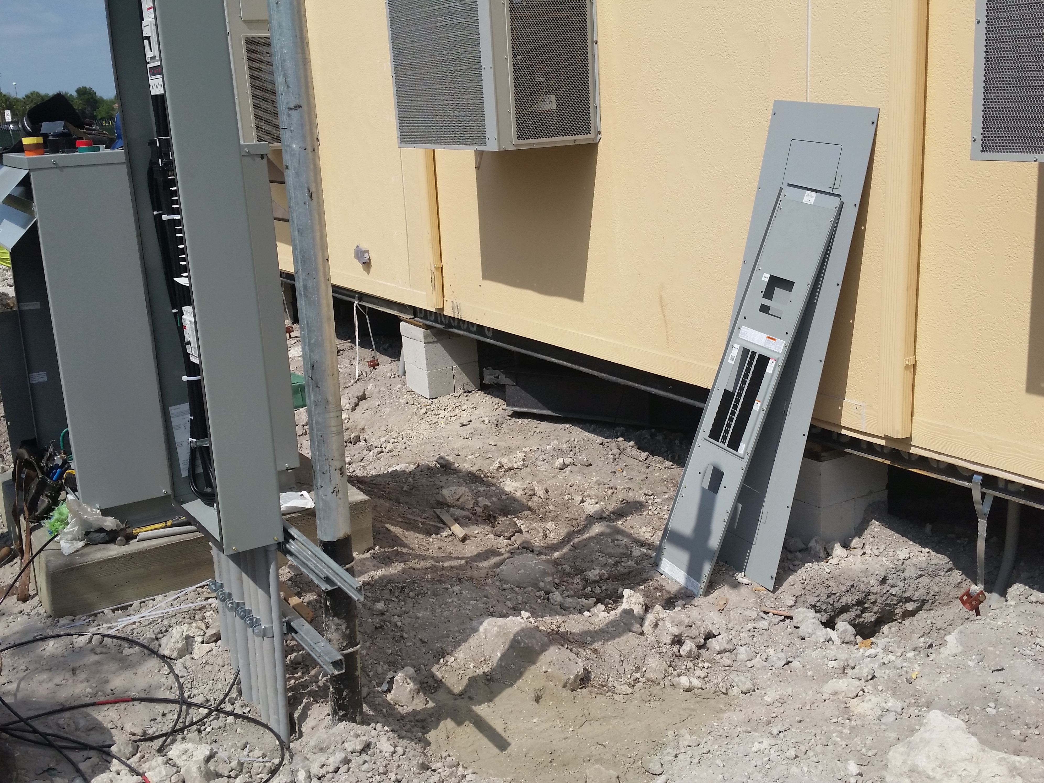 Modular building installation and utility hookup.